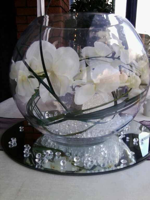 Fishbowl Centrepeice Hire filled with realistic flower spray and table diamonds